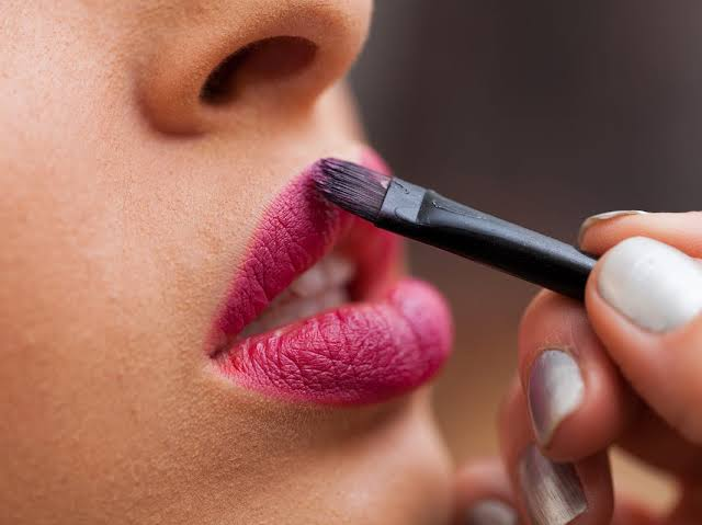 lipstick being used as a brush