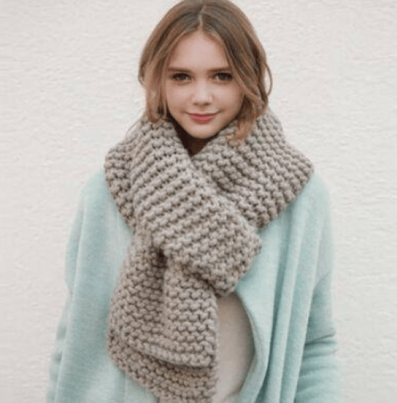 women wearing knitted scarf in winters