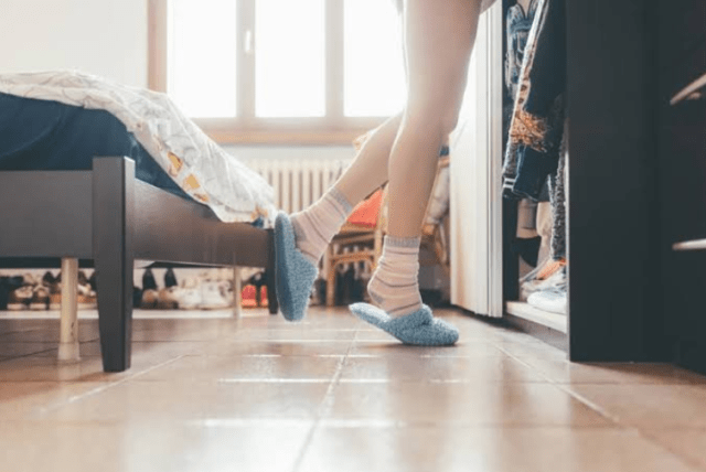 female wearing slippers at home