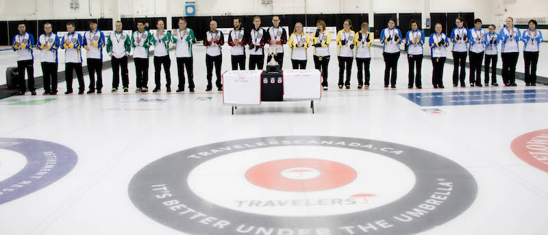 The medallists at the 2016 Travelers Curling Club Championship take to the ice in preparation for the trophy presentation at the Kelowna Curling Club (Curling Canada/Jessica Krebs photo)