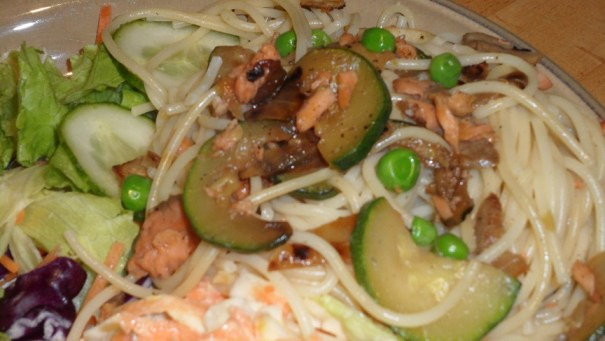 Salmon spaghetti with peas, mushrooms, spring onions, natural yoghurt and a little grated parmesan cheese.