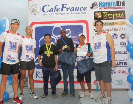 In the photo are Ivan Mayrina, Paolo Abrera, 10K first placer Willy Rotich (4th from left), Karate Kid Japanese Fastfood Vice-Chairman Raymond Yap together with the other placers.