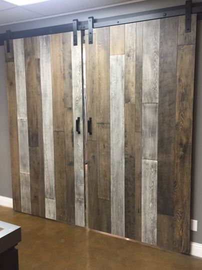 Mannington Adura installed on moving barndoors for a rustic look with an easy to clean surface.