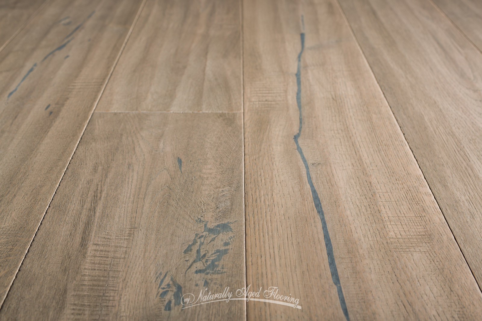 Unique colors and textures help customize spaces, individualizing tastes and styles specific to you. This Naturally Aged Hardwood has high contrast veining with light hand scraped texture.
