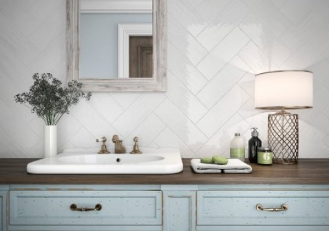 High gloss white subway tiles come alive in this herringbone pattern. Source: MAY Madison)