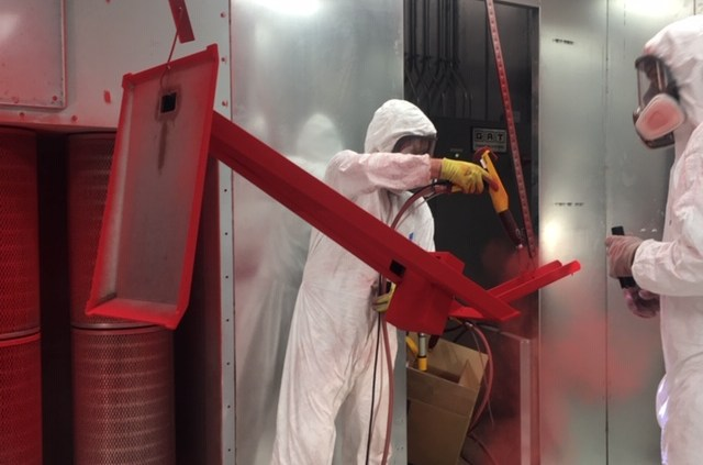 Powder Is Applied to Item During Powder Coating Process