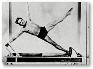Joseph Pilates doing Star on the Reformer
