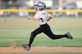 kid running the bases, full of pride
