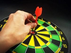 dart thrown to bullseye