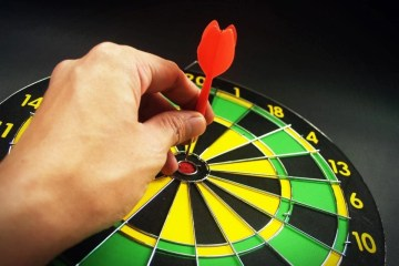 dart thrown to bullseye