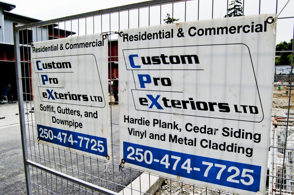 Custom Pro Exteriors sign on construction project.