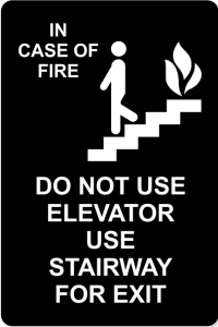"Black Sign w/ White Text - ""In Case of Fire - Do Not Use Elevator"""