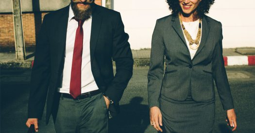 Two Business People Walking Towards the Camera