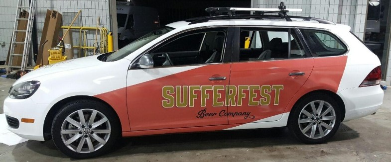 sufferfest beer car wrap left