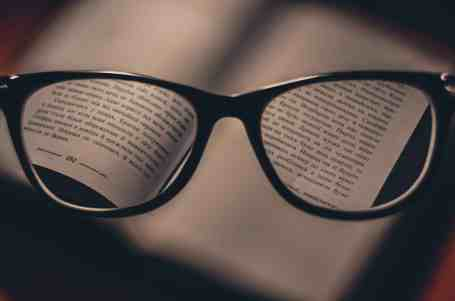 A pair of black-framed glasses puts the fine print in focus
