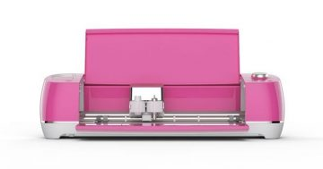 This bright pink Cricut Explore Air 2 opens to reveal the dual tool holder.