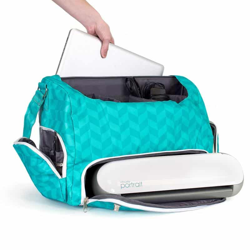 The Portrait 2 fits easily in this teal tote, along with a laptop