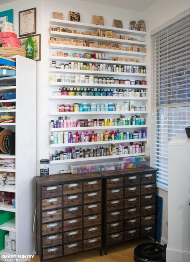 Rainbow wall of paints and inks sits on top of card catalogs