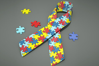 The colored Autism Awareness Ribbon - The puzzle pattern reflects the mystery and complexity of the autism spectrum.