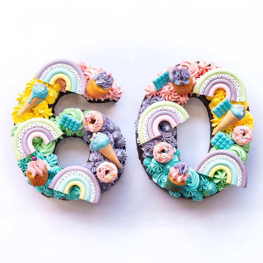 Eine 60 als Pastell Regenbogen Zahlenkuchen