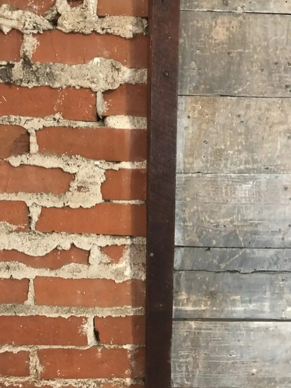 Exposed brick & reclaimed wood wall