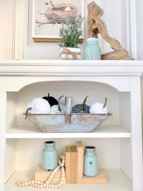 rustic bookshelf styling with fabric pumpkins