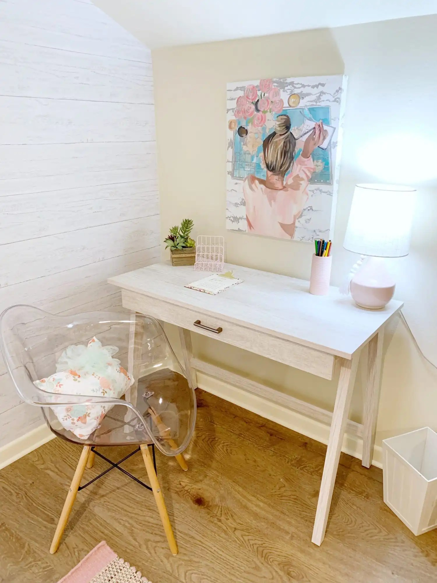 The study area in a teenage girls bedroom with desk and chair.