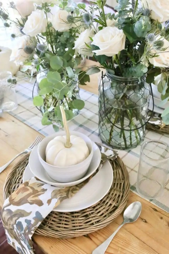 Add a pumpkin for fall at each table setting
