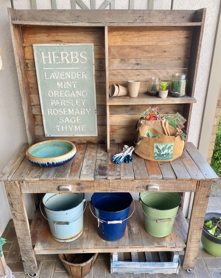 chalk painted Herb sign displayed on potting bench