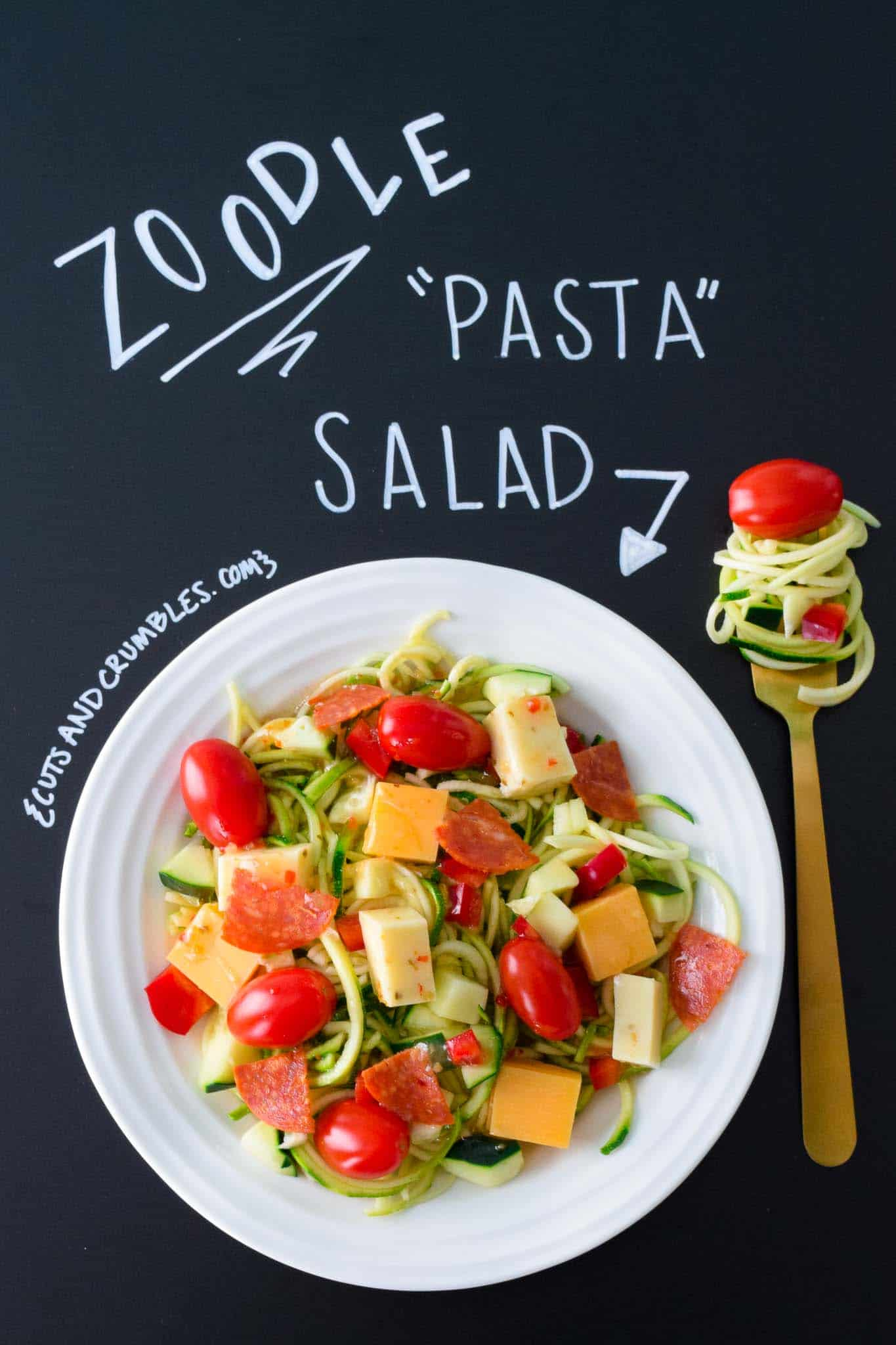 Zoodle Pasta Salad in white bowl with title written on chalkboard