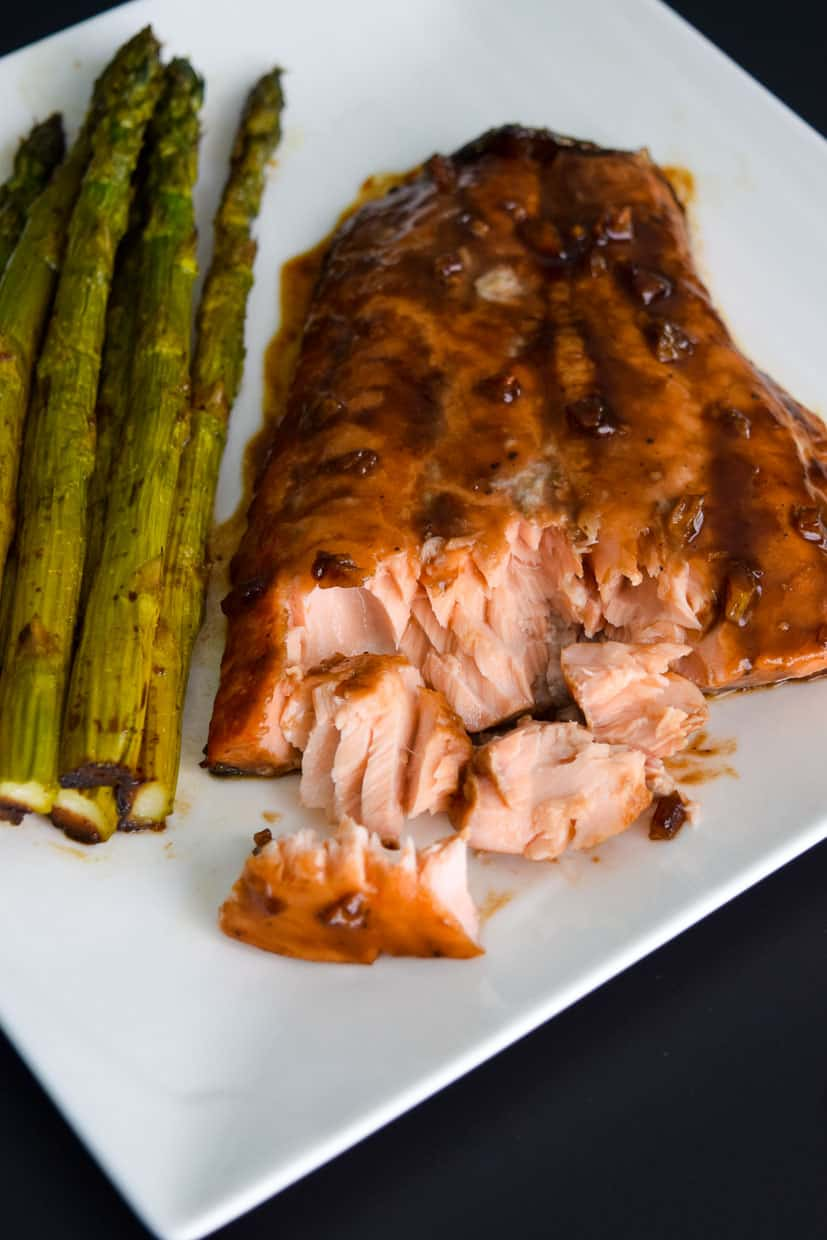 Easy Balsamic Roasted Salmon close up view on white plate ready to be eaten