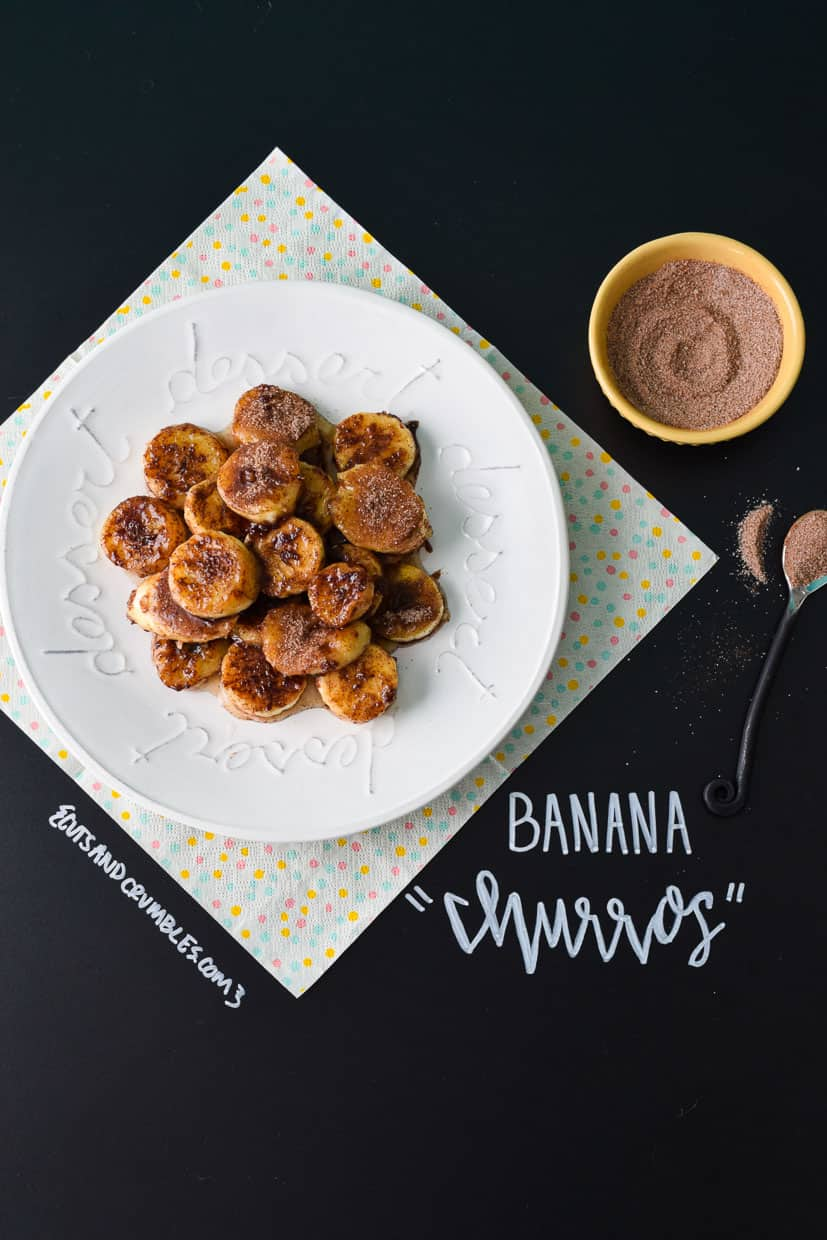 Banana Churros on white plate with title written on chalkboard