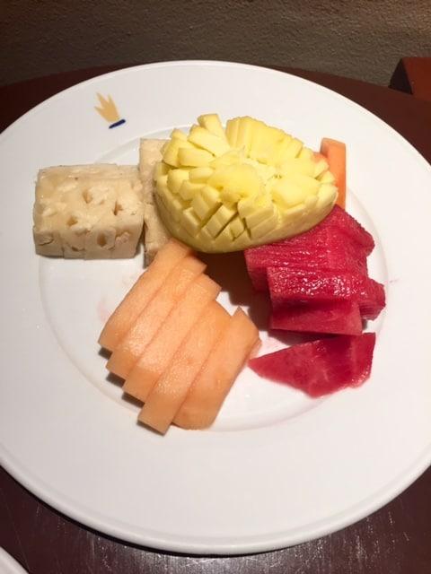 Plate of fresh fruit overhead shot