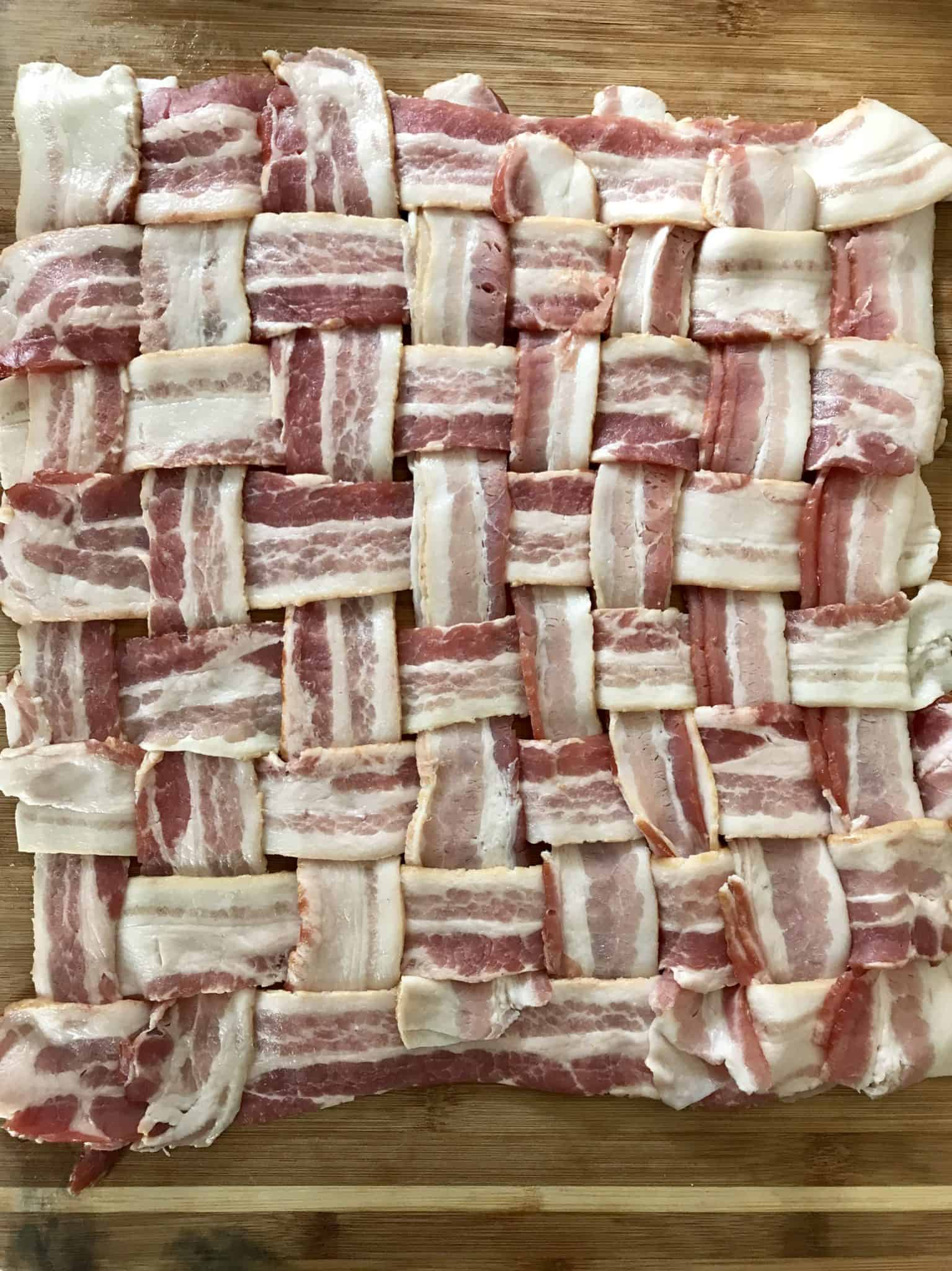 Bacon weave on wooden cutting board overhead shot