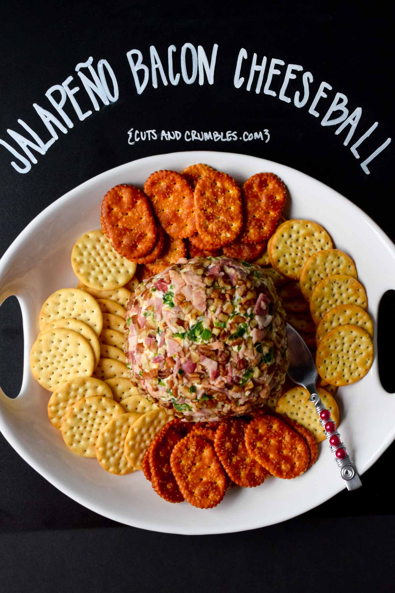 Jalapeño Bacon Cheeseball with title written on chalkboard