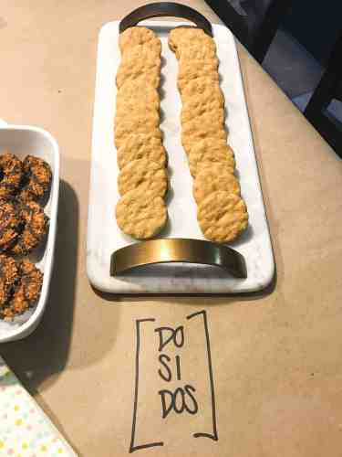 Girl Scout cookie do si dos on white platter