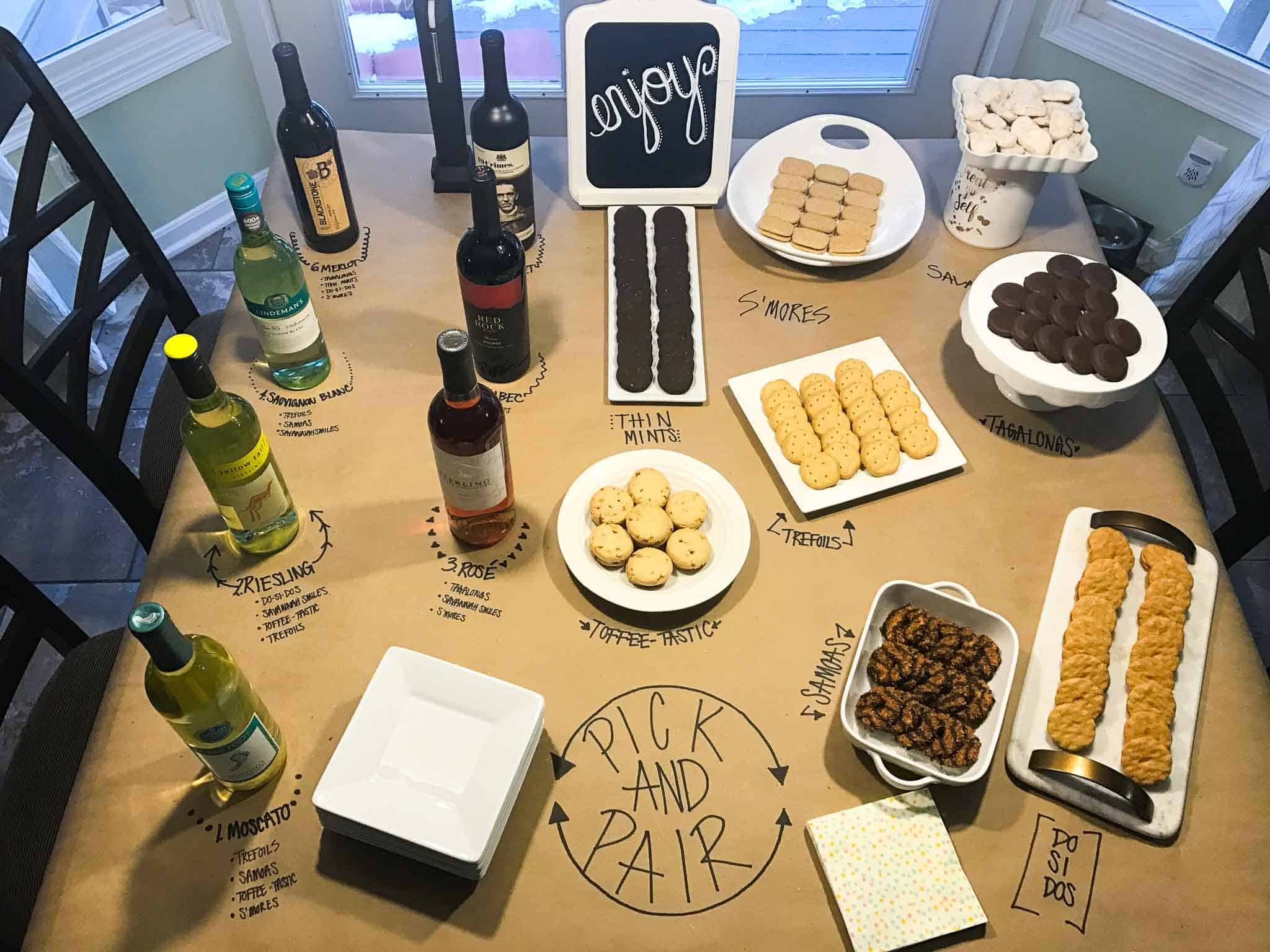 girl scout cookie and wine pairing set up on kitchen table overhead shot