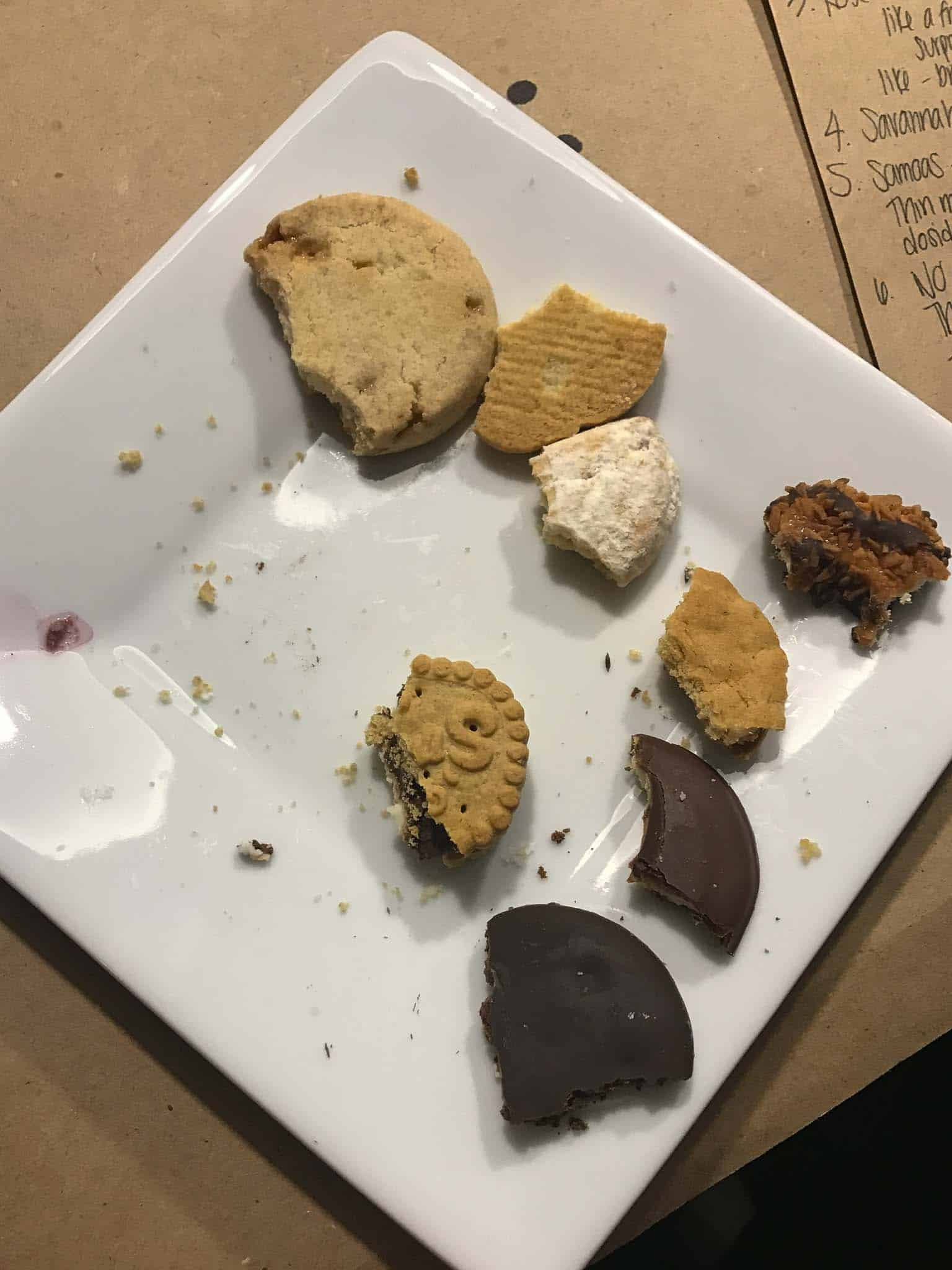plate of Girl Scout cookies with small bites taken out of each one