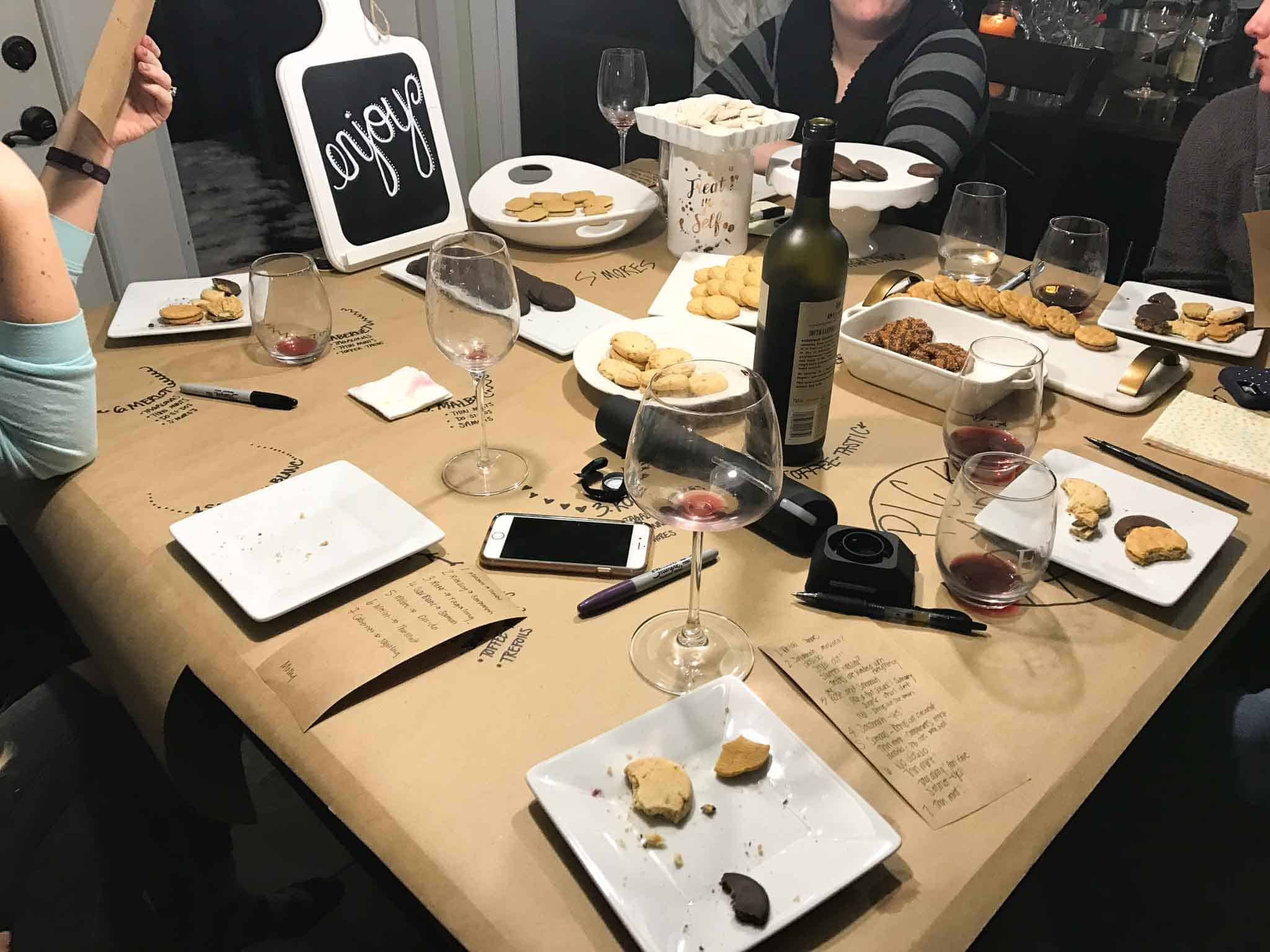 girl scout cookie and wine pairing night with girls sitting around table and voting