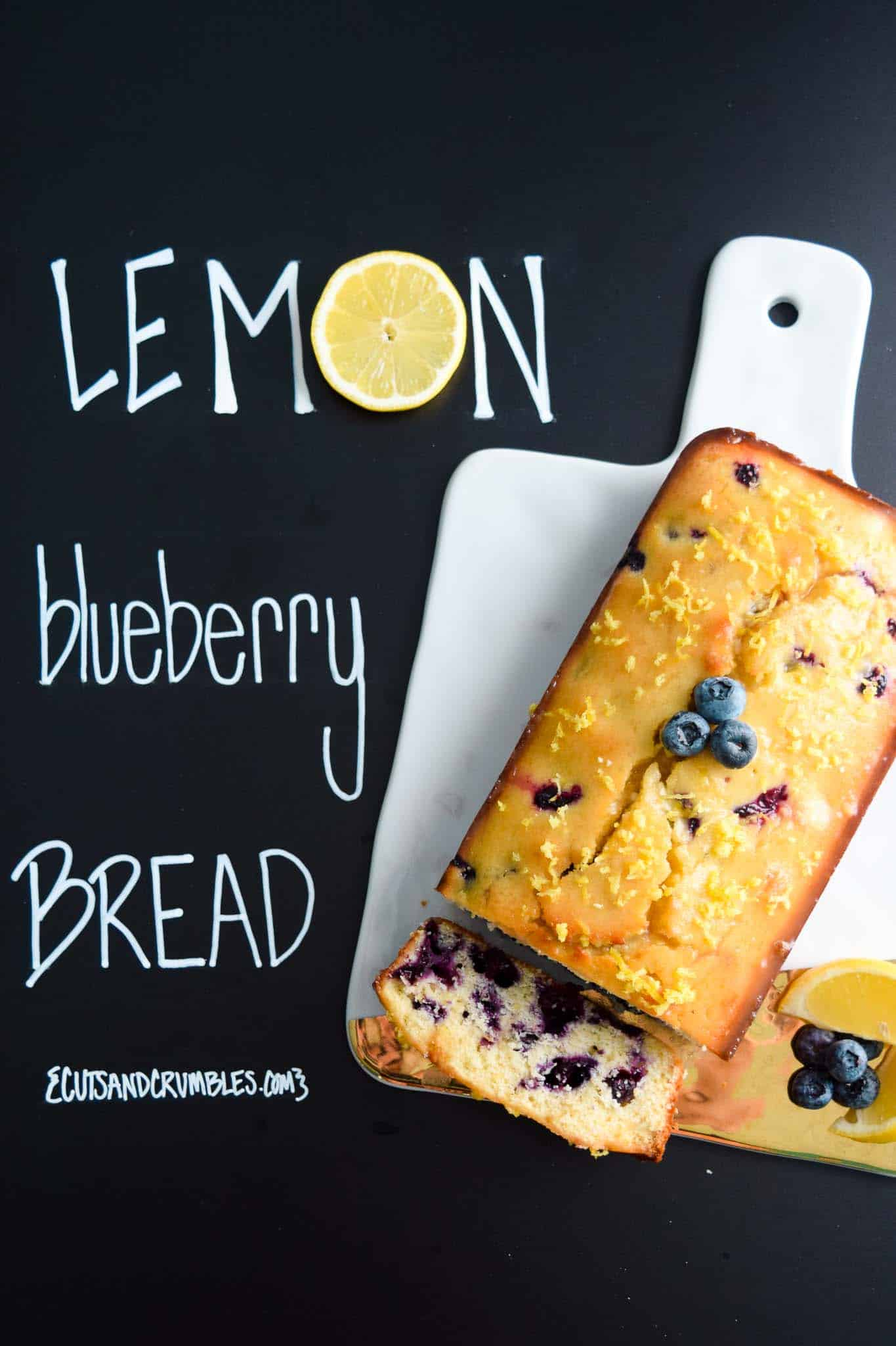 lemon blueberry bread with title written on chalkboard