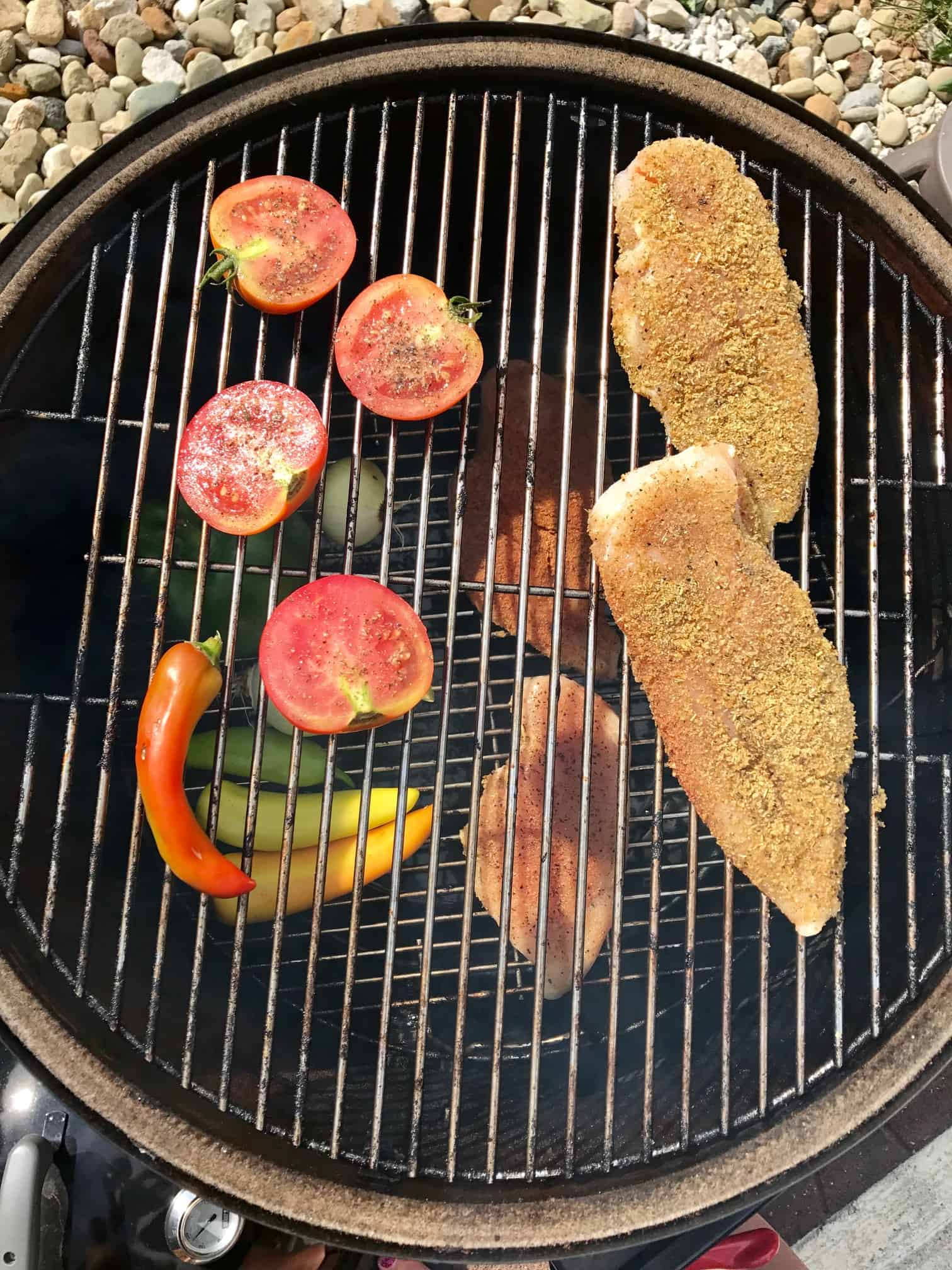 Chicken and vegetables on weber grill overhead shot