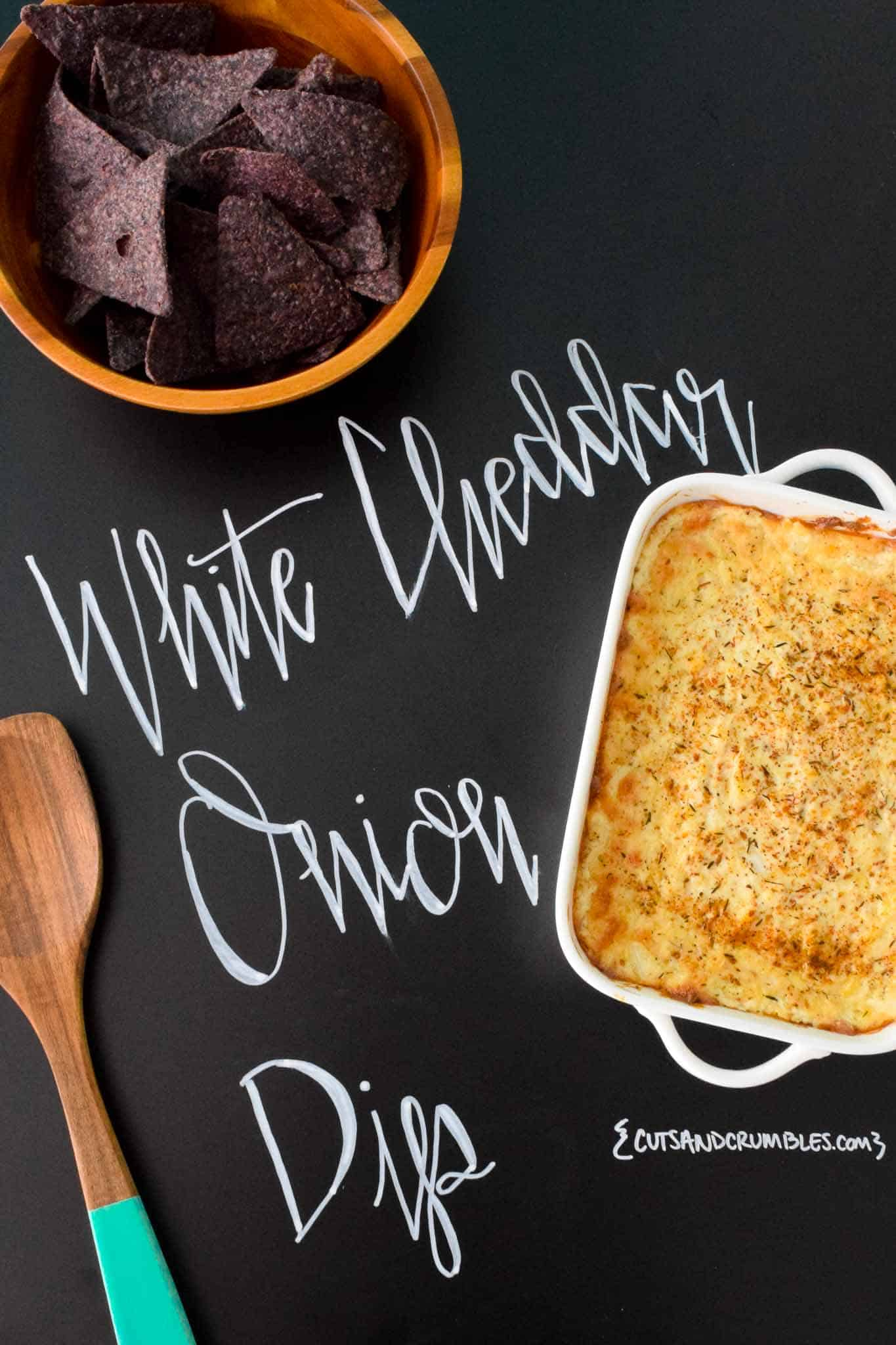 White Cheddar Onion Dip with title written on chalkboard