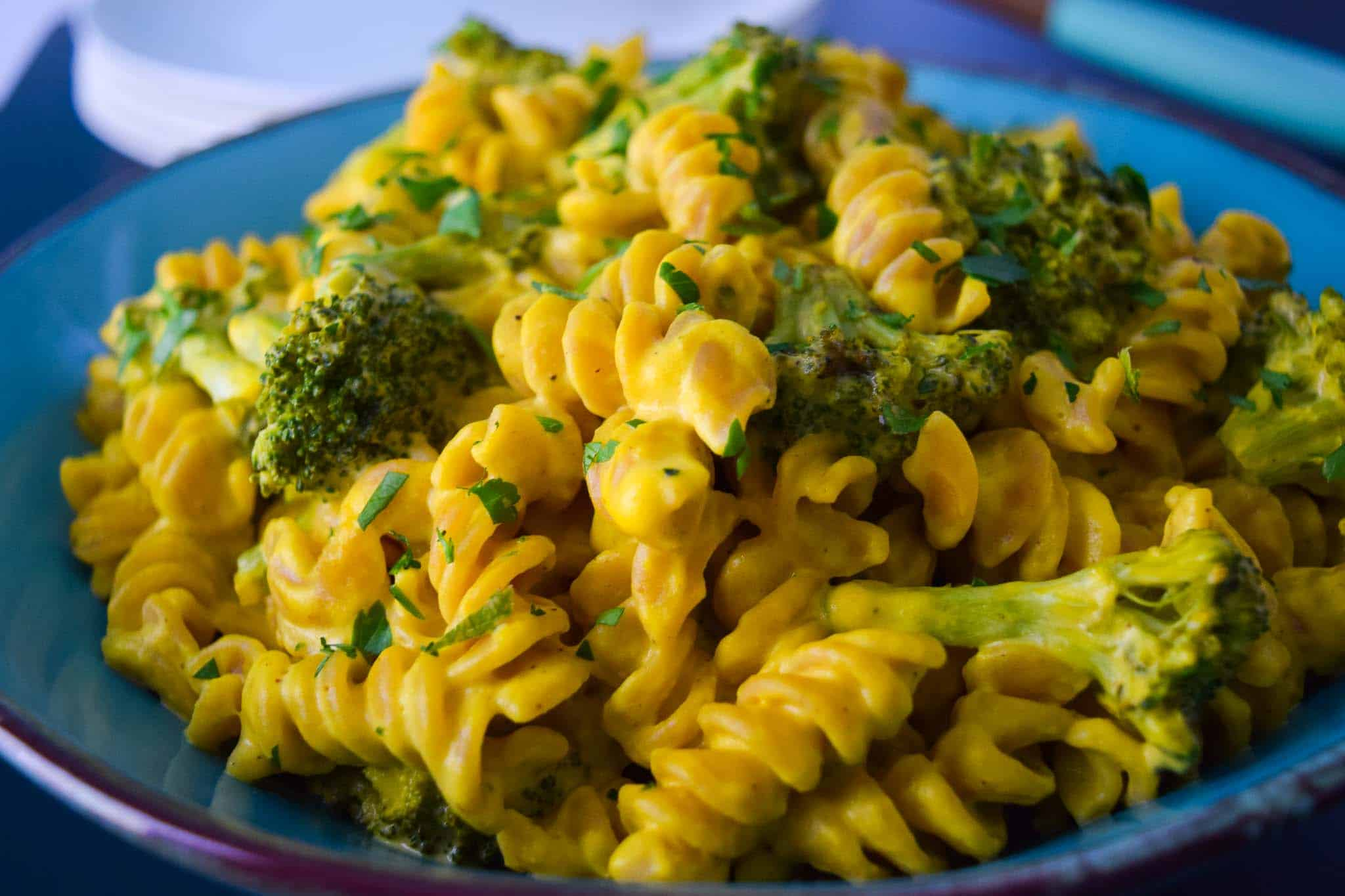 Secret Ingredient Roasted Broccoli Rotini on blue plate close up