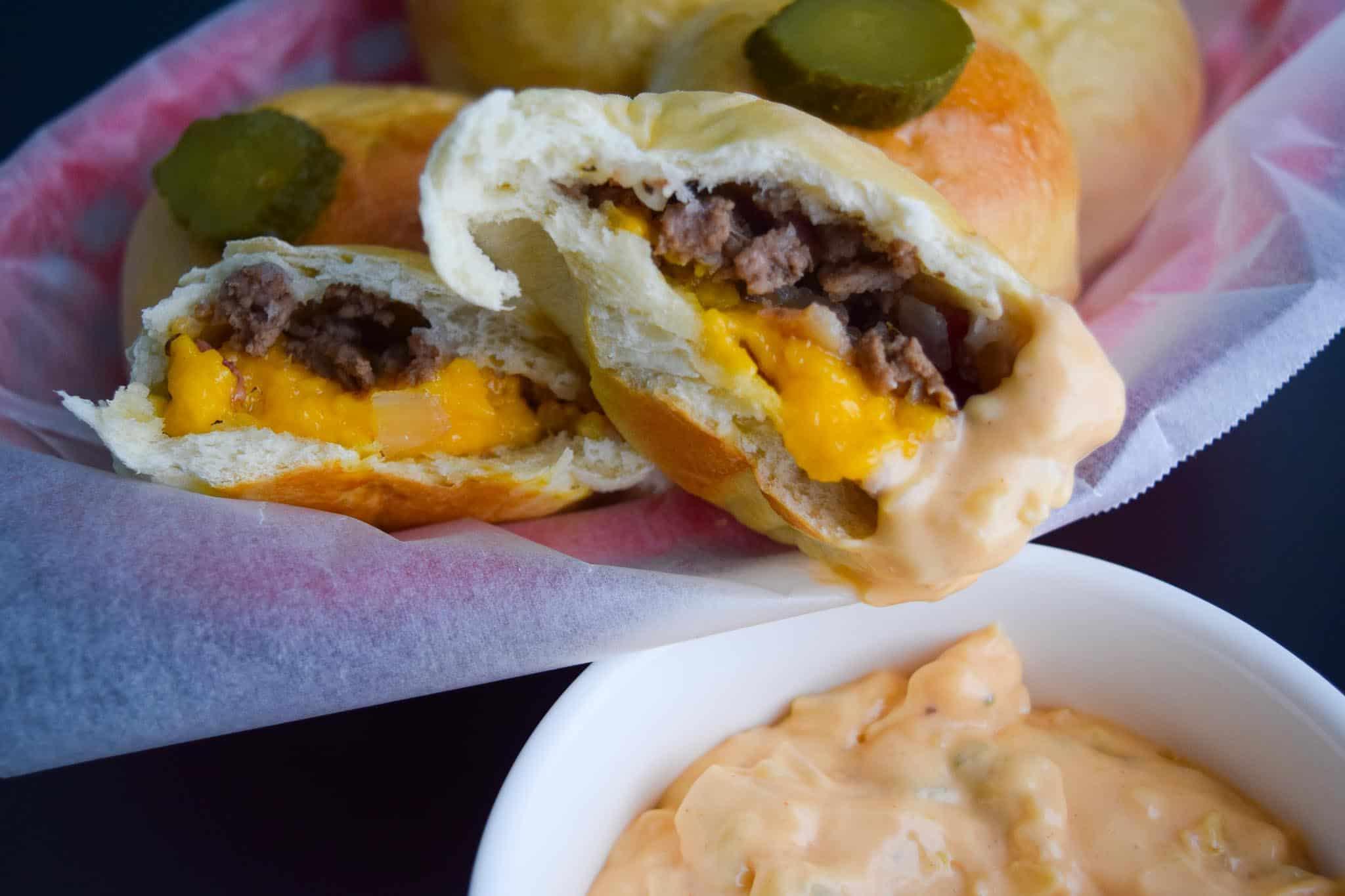 Bacon Cheeseburger Bombs dipped in Big Mac Sauce close up view