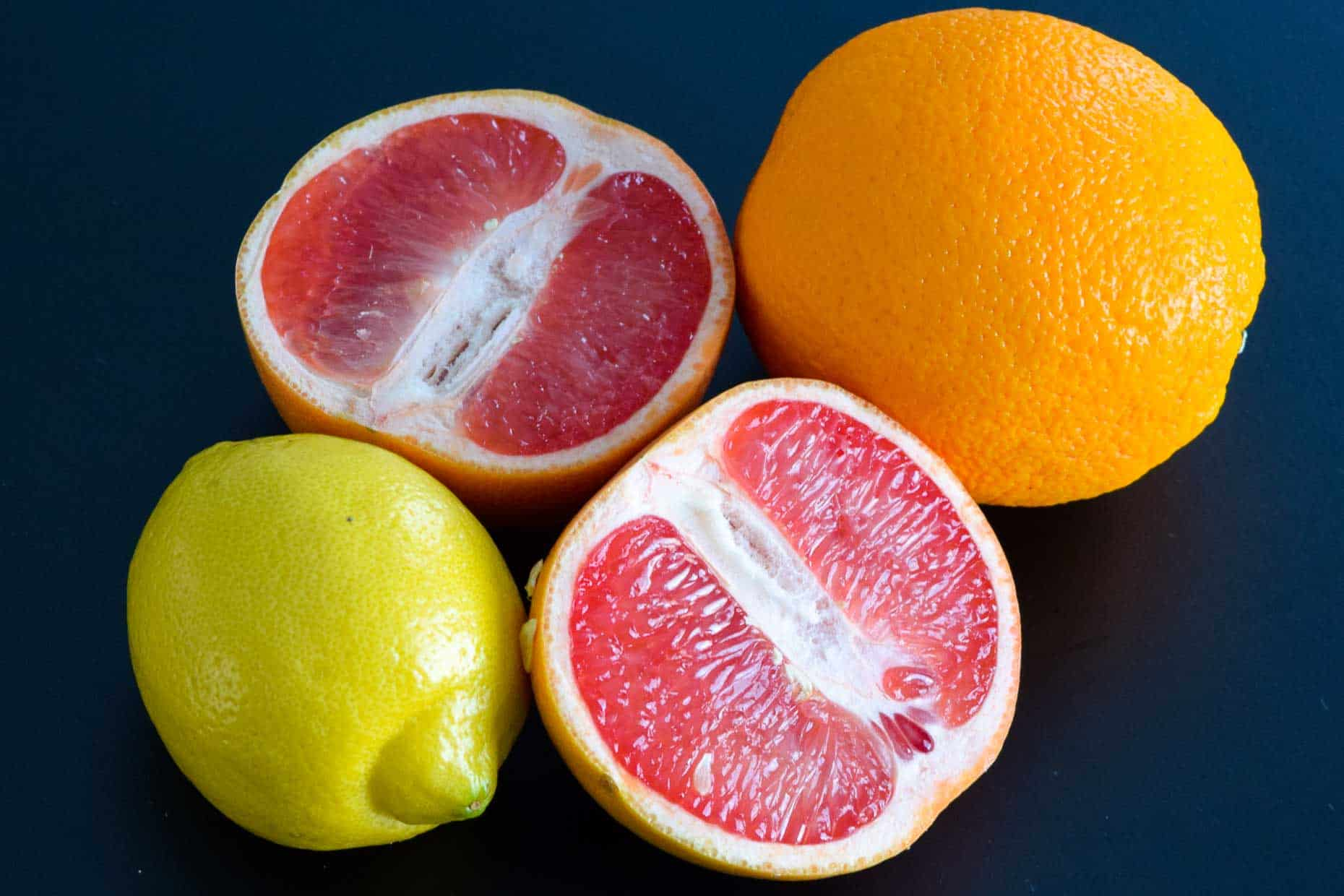 Citrus fruits on black background