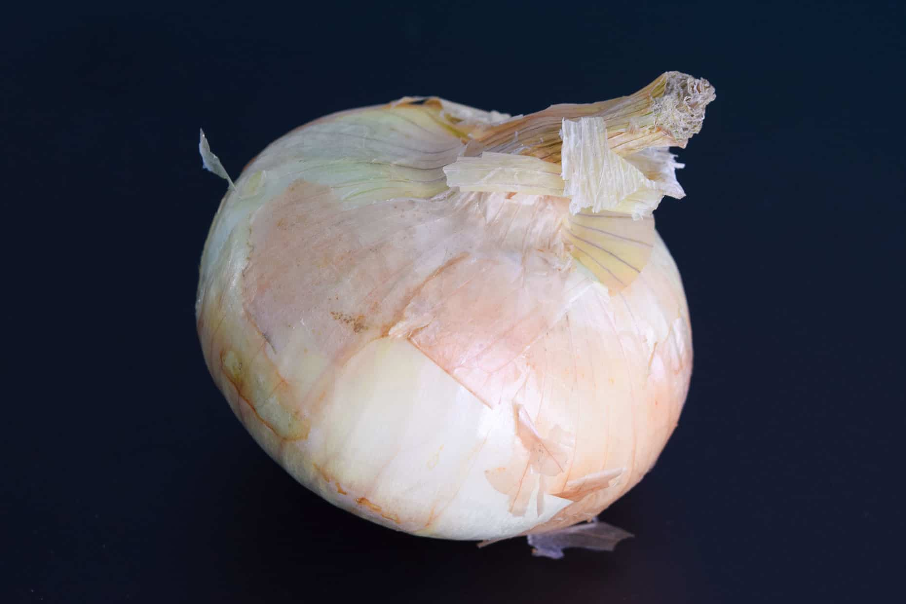 Vidalio onion on black background