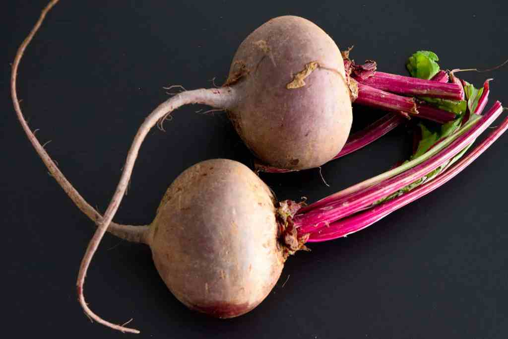 beets on black background