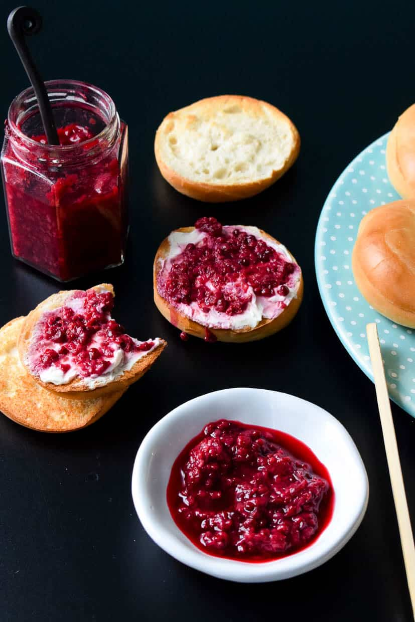 Fresh Mixed Berry Compote in white bowl with mini bagels