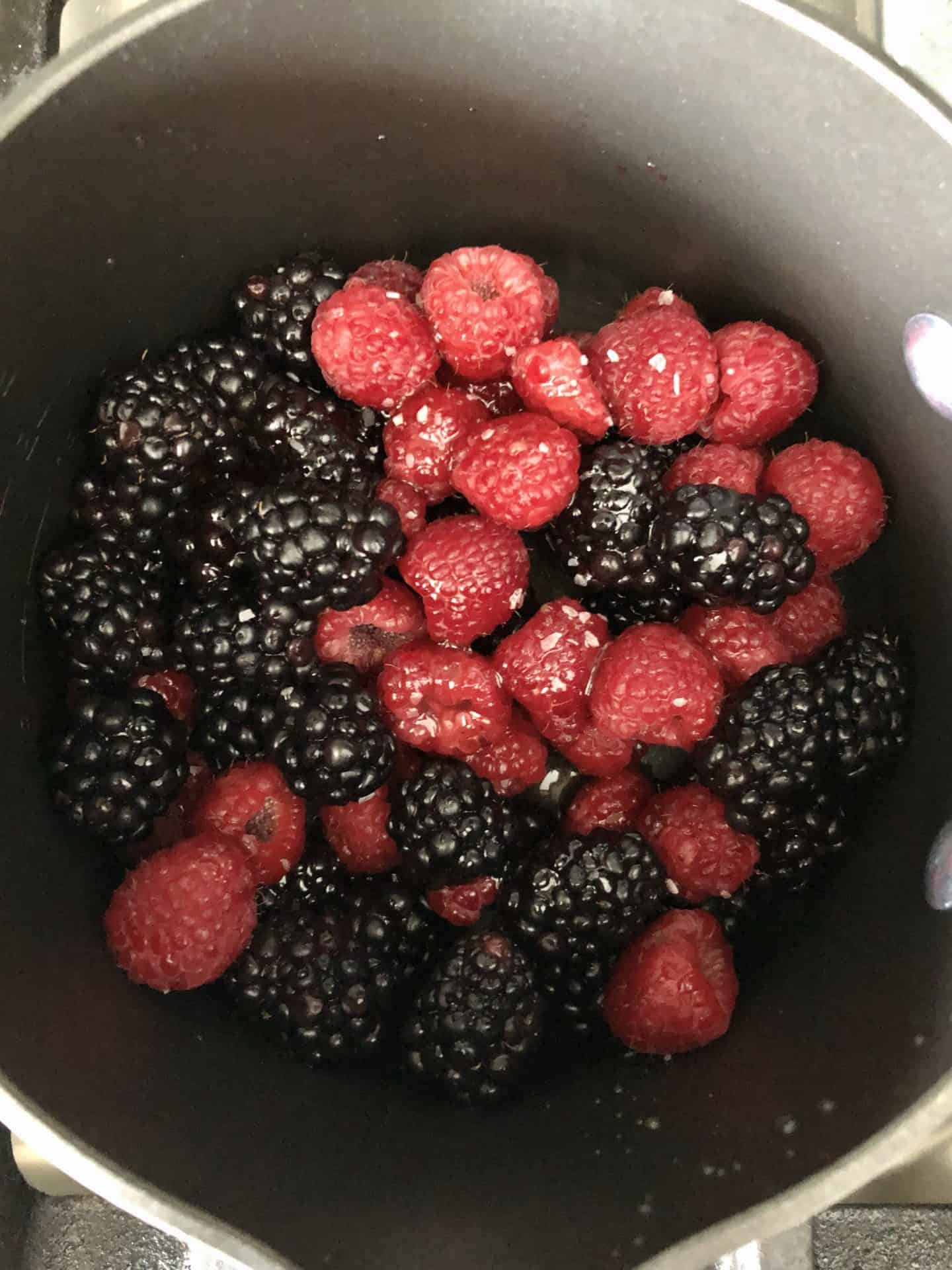 Raspberries and blackberries in pot ready to be cooked
