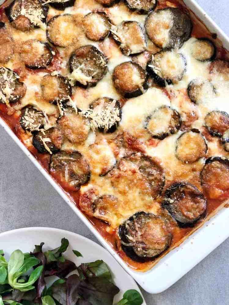 white pan of eggplant parmesan